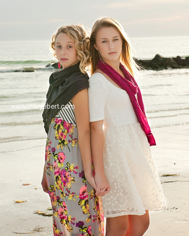 Sisters during family photo session at Honeymoon Island, Tampa Bay